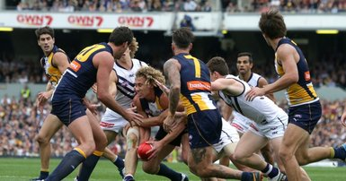 Footy juggernaut keeps bottom lines black
